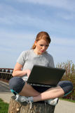 Pretty Young Woman Outdoor with Computer Stock Images
