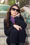 Pretty Young Woman Outdoor Lifestyle. Pretty young woman at an outdoor shopping mall speaking on a mobile phone Stock Photography