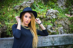 Pretty young woman outdoor in park Stock Images