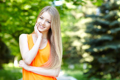 Pretty young woman outdoors. Stock Photos