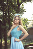 Pretty young woman. In park Royalty Free Stock Image