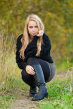 Pretty young woman in a park in a autumn day Royalty Free Stock Images