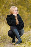 Pretty young woman in a park in a autumn day Stock Photo