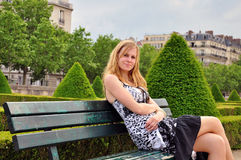 Pretty young woman in the park Royalty Free Stock Photos
