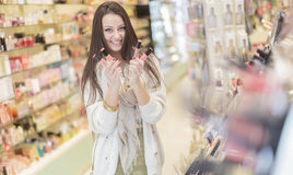 Pretty young woman in perfumery Royalty Free Stock Images