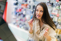 Pretty young woman in perfumery Stock Photography