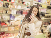 Pretty young woman in perfumery Royalty Free Stock Photo