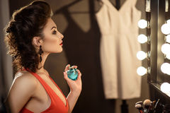 Pretty young woman perfuming herself Royalty Free Stock Photography