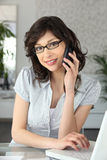 Pretty young woman on phone Royalty Free Stock Photos