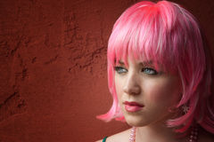 Pretty young woman with pink hair Stock Photos