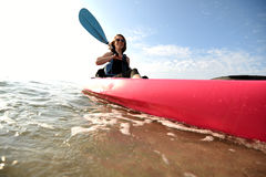 Pretty young woman in pink kayak Stock Photos