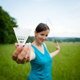 Pretty, young woman playing badminton Stock Photo