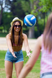 Pretty young woman playing with a ball in the city park - Sunset Royalty Free Stock Images