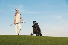 Pretty young woman playing golf. Golf Concept Stock Photos