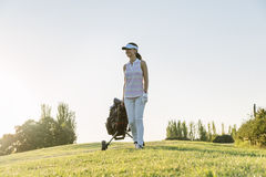 Pretty young woman playing golf. Golf Concept Royalty Free Stock Image