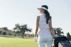 Pretty young woman playing golf. Golf Concept Royalty Free Stock Photography