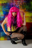Pretty young woman playing with her bright pink hair Stock Image