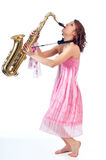 Pretty young woman playing a saxophone Royalty Free Stock Photos
