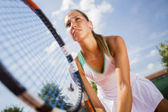 Pretty young woman playing tennis royalty free stock images