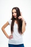 Pretty young woman pointing finger up Stock Photos