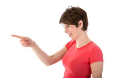Pretty young woman pointing with her finger Royalty Free Stock Images