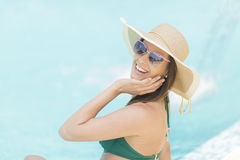 Pretty young woman by pool Stock Images