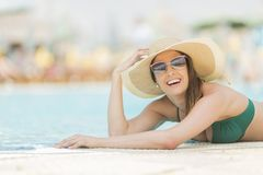 Pretty young woman by the pool Stock Image