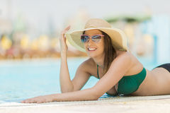 Pretty young woman by the pool Royalty Free Stock Photography