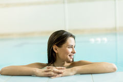 Pretty young woman in the pool Stock Photography