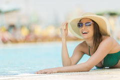 Pretty young woman by the pool Royalty Free Stock Photos