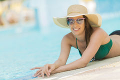 Pretty young woman by the pool Royalty Free Stock Photo