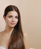 Pretty young woman portrait with long hair looking at camera Stock Photos