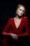 Pretty young woman portrait in red dress Royalty Free Stock Photography