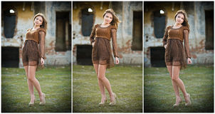 Pretty young woman posing in front of the farm. Very attractive blonde girl with brown short dress. Romantic young woman posing Stock Photography
