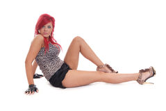 Pretty young woman posing sat down with red hair Stock Images