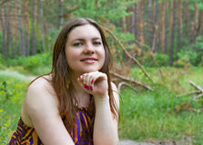Pretty young woman posing in the summer forest Stock Image