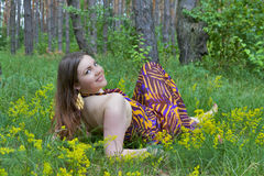 Pretty young woman posing in the summer forest Stock Photo