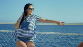 Pretty young woman posing during traveling by boat among the islands. Pretty young woman posing during traveling by boat among the islands stock video footage