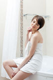 Pretty young woman posing in white towel Stock Photos