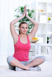 Pretty young woman practicing yoga Royalty Free Stock Images