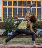 Pretty Young Woman Practicing Yoga in the Park (Extended Side Angle) Stock Images