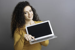 Pretty young woman pressing the button on computer Stock Photo