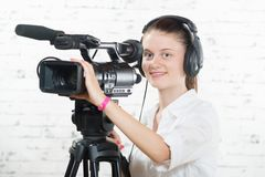 A pretty young woman with a professional camera Royalty Free Stock Image