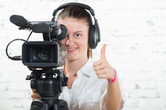 A pretty young woman with a professional camera Stock Photos