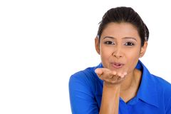 Pretty young woman puckering up lips to blow kiss Stock Image