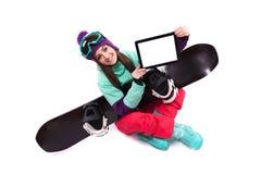 Pretty young woman in purple ski costume siting cross-legged, sh Stock Image
