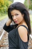 Pretty young woman on the railroad royalty free stock photo
