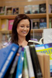 Pretty young woman reading a book Stock Photo