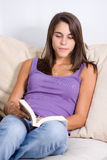 A pretty young woman reading a book Royalty Free Stock Photo