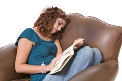 Pretty young woman reading book royalty free stock photos